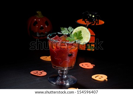 Closeup of Bloody Mary cocktail, garnished with lemon and parsley - Halloween drinks series  - stock photo