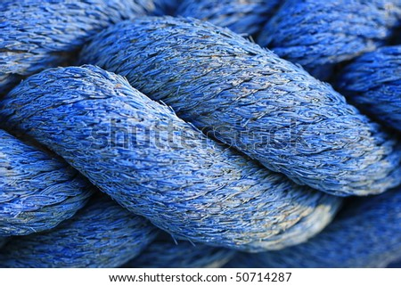 Closeup of blue coiled rope - stock photo
