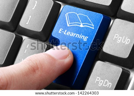 Closeup of blue e-learning button on the keyboard - stock photo