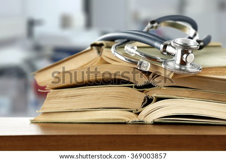 closeup of books and hospital place  - stock photo