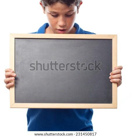 closeup of boy with a blackboard - stock photo