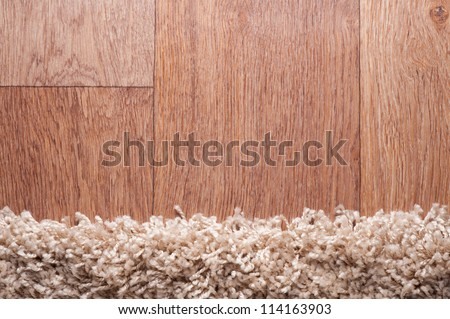 closeup of brown carpet on a wood surface - stock photo