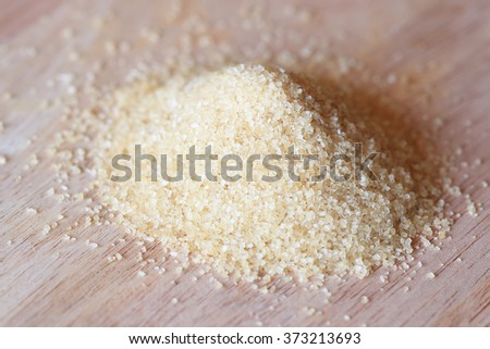 Closeup of brown sugar cane on the wooden background - stock photo