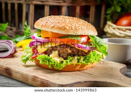 Closeup of burger made from vegetables and beef - stock photo