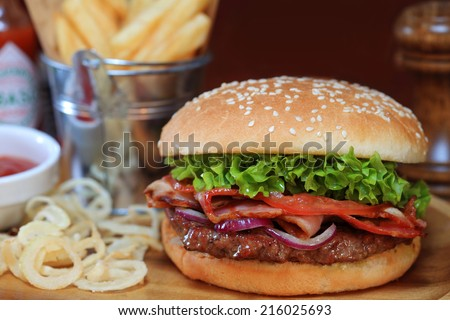 Closeup of burger made from vegetables, beef and fried bacon - stock photo