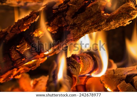 closeup of burning wood in a fireplace - stock photo