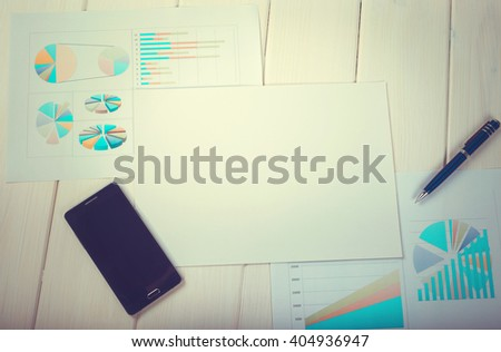 Closeup of business documents on the table. Planning of future work. Working in the office. Concept of the business day. Toned image. - stock photo