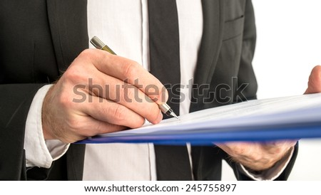 Closeup of business man signing legal document on a map. - stock photo