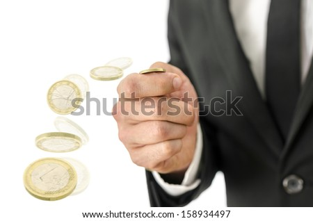 Closeup of business man tossing a coin. Motion blur. - stock photo