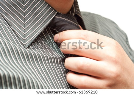 closeup of business man tying a tie - stock photo
