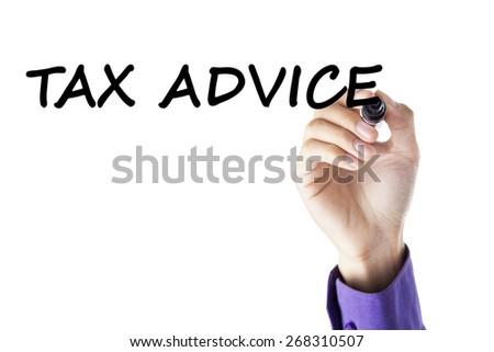 Closeup of businessman hand using marker to write tax advice on whiteboard - stock photo