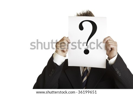 Closeup of businessman holding a sheet with question mark in front of his face. - stock photo