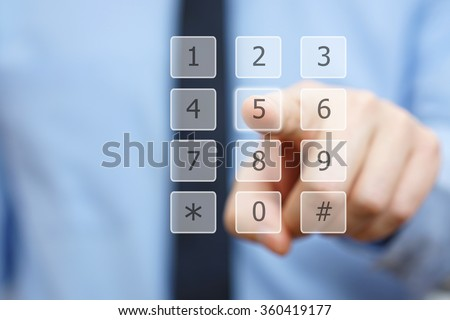 closeup of businessman's hand dial a number on virtual keypad - stock photo