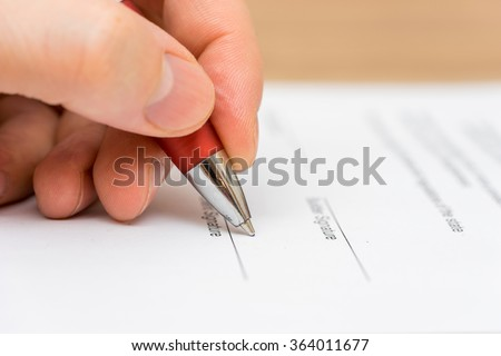 Closeup of businessman  signing contract - stock photo