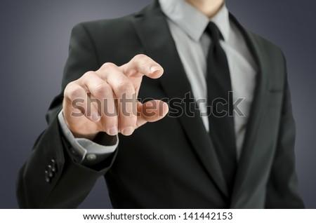 Closeup of businessman touching empty virtual screen. - stock photo