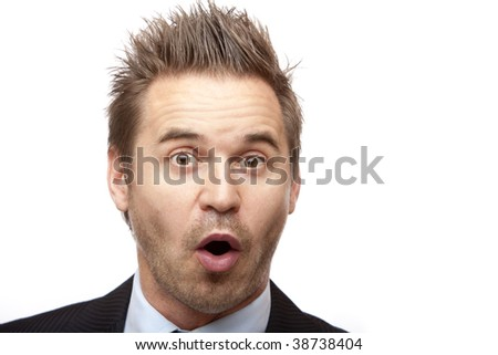 Closeup of businessman which looks positive surprised on white background - stock photo