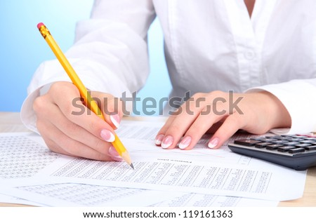 Closeup of businesswoman hands, working in office room - stock photo