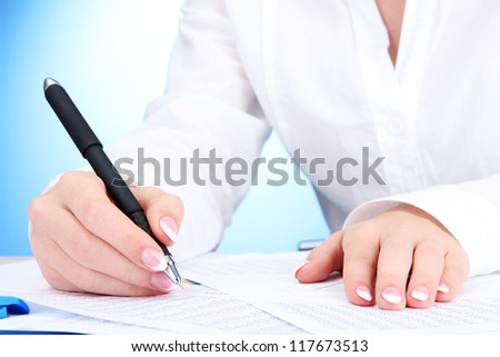 Closeup of businesswoman hands, writing on paper - stock photo