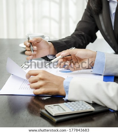 Closeup of businesswomen hands on discussion - stock photo