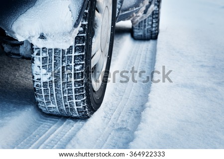 Closeup of car tires in winter  - stock photo