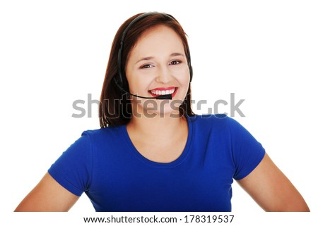 Closeup of casual customer support representative smiling with headset on white background  - stock photo