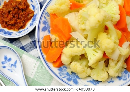 Closeup of cauliflower dish cooked with carrots. - stock photo