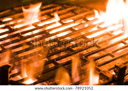 Closeup of charcoal burning under a barbecue grill - stock photo