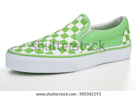 Closeup of checkerboard shoe on white background - stock photo