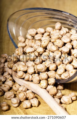 Closeup of  chickpeas in bowl on wooden table - stock photo