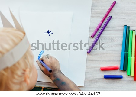 Closeup of child drawing on white paper. Children's Creative Workshop - stock photo