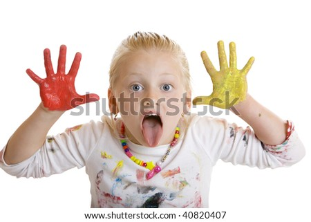 Closeup of child with painted hands makes a grimace - stock photo