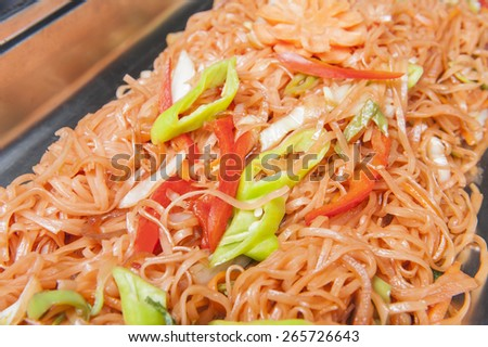 Closeup of chinese stir fried noodles on display at a hotel restaurant buffet - stock photo