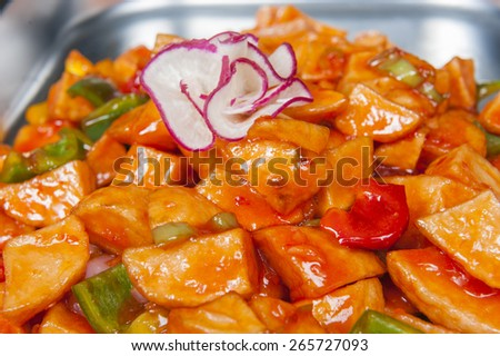 Closeup of chinese sweet chilli potatoes meal on display at a hotel restaurant buffet - stock photo