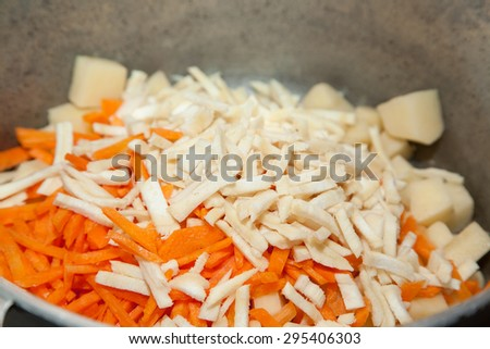 Closeup of chopped raw parsley root with carrots - stock photo