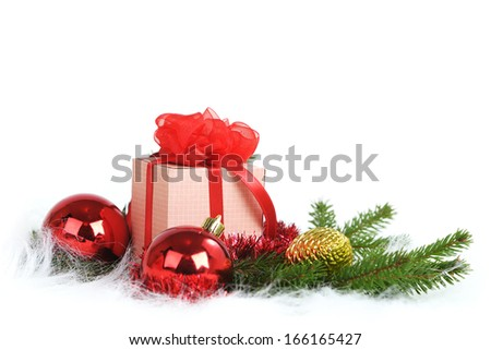 Closeup of Christmas ball with pine branch and gifts on white background - stock photo
