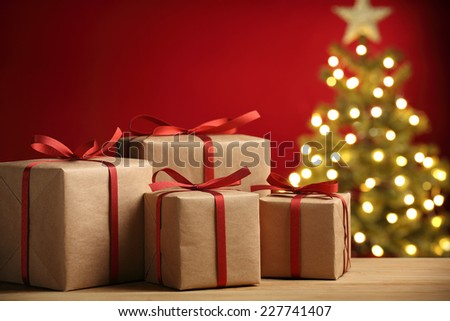 Closeup of Christmas gift boxes on festive background - stock photo