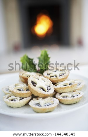 Closeup of Christmas mince pies on plate - stock photo
