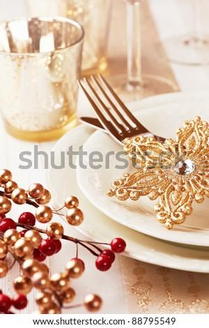 Closeup of christmas place setting - stock photo