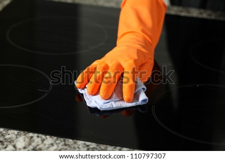 Closeup of cleaning a cooker with rubber - stock photo
