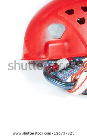 Closeup of climbing gear with sky background - stock photo