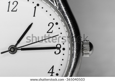 Closeup of clock face with hands - stock photo