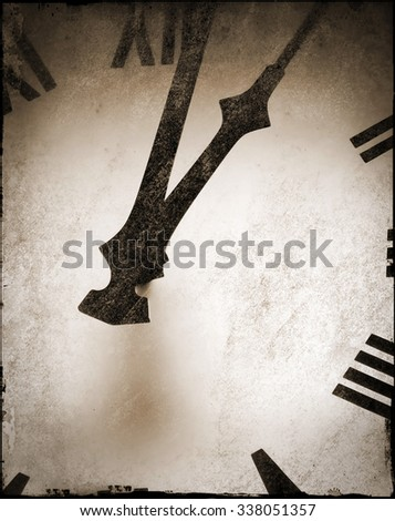 Closeup of clock face with roman numbers. Grunge effect applied giving old worn look. - stock photo