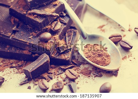 Closeup of Cocoa Powder and Dark Chocolate/ Chopped chocolate with cocoa - stock photo