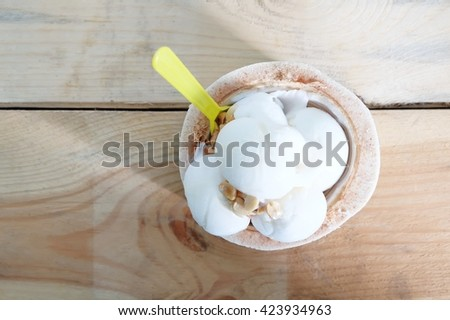 Closeup of coconut ice cream with nuts - stock photo
