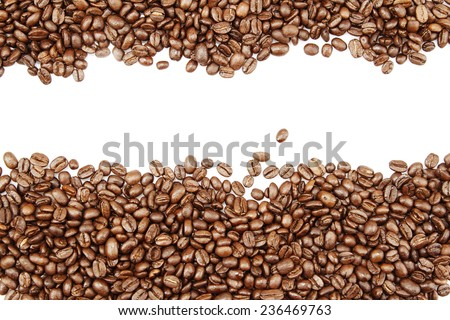 Closeup of coffee beans on plain background. Copy space - stock photo