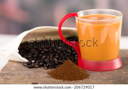 closeup of cofffe cup powder coffee and coffee beans selective focus - stock photo