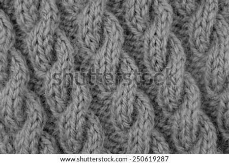 Closeup of coiled rope cable stitch knitting on the diagonal - monochrome processing - stock photo