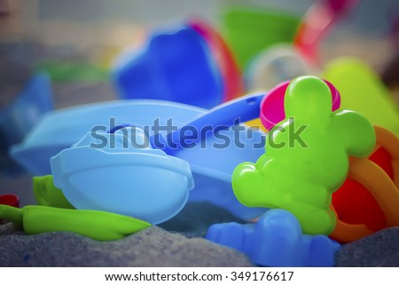 Closeup of colorful childrenâ??s sand toys - stock photo