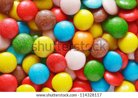 Closeup of colorful chocolate candies as background - stock photo