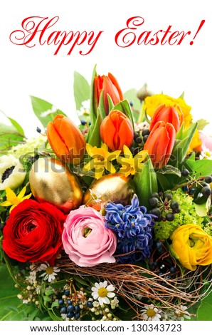 closeup of colorful easter bouquet with golden eggs decoration and sample text Happy Easter! - stock photo